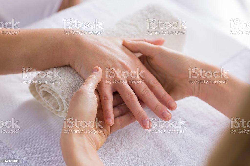 Beauty therapist massaging customers hand royalty-free stock photo