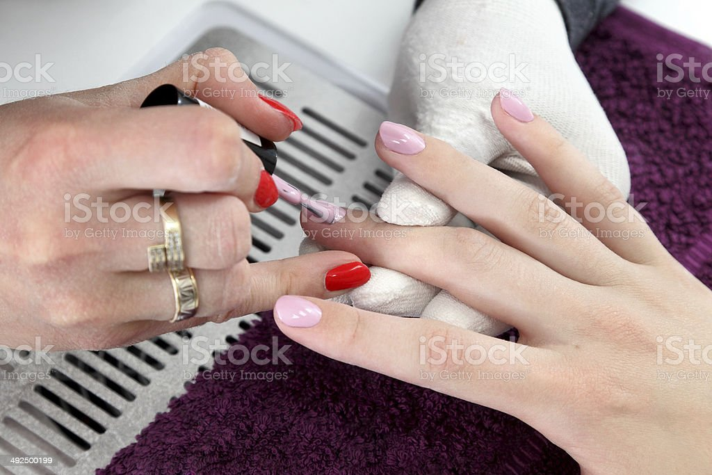 Beauty treatment of fingernails royalty-free stock photo