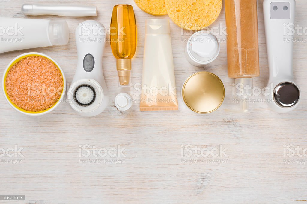 Beauty treatment products on wooden background with copyspace at bottom stock photo