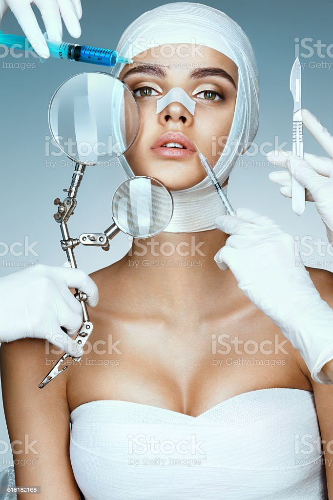 Beauty victim wrapped in medical bandages stock photo