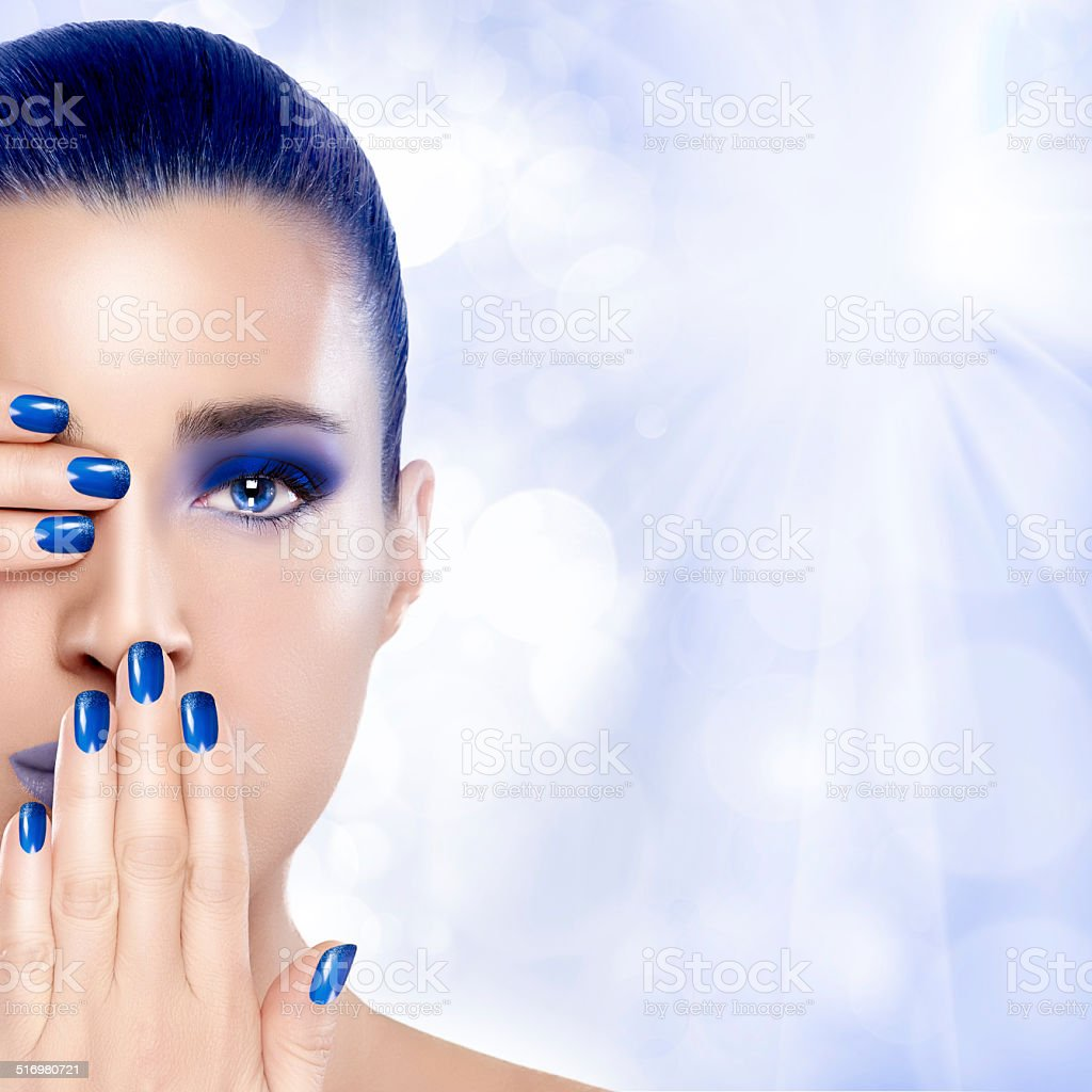 Beauty Winter Girl in Blue. Nail Art and Makeup Trend stock photo