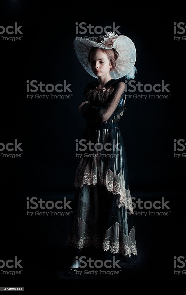 Beauty with hat in long dress stock photo