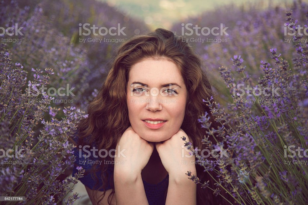 Beauty with her flowers stock photo