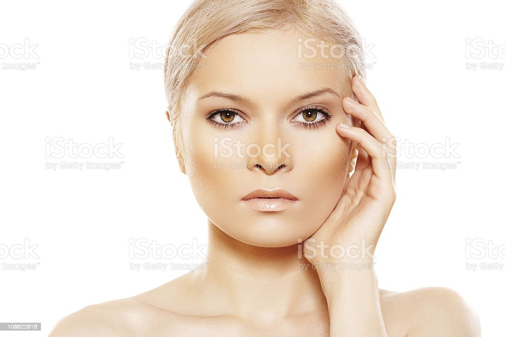 Beauty with natural day make-up touching her face royalty-free stock photo
