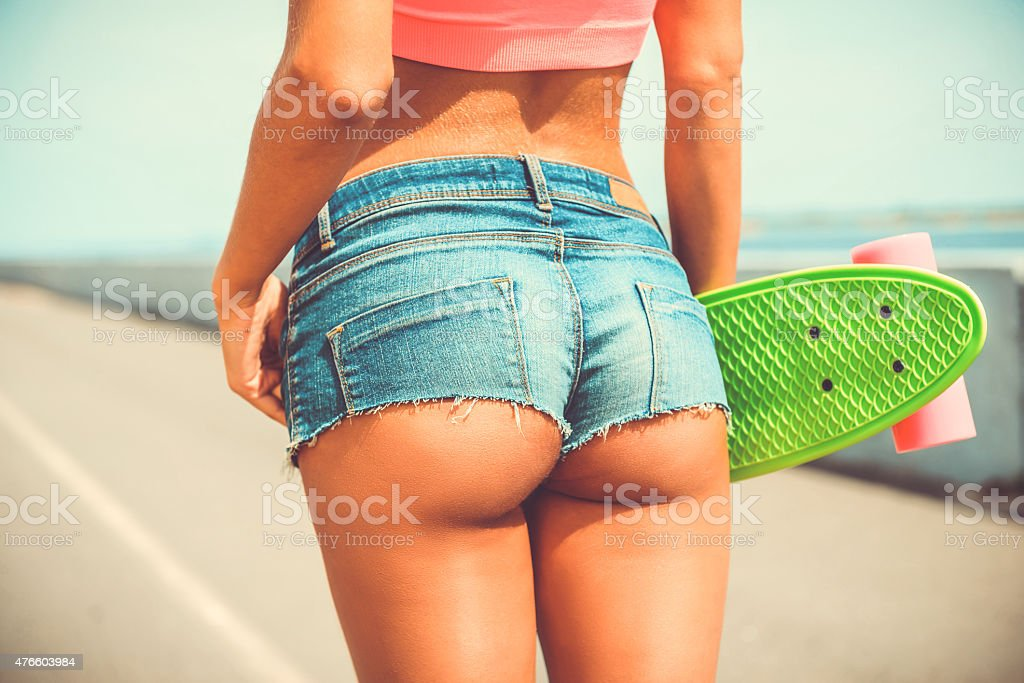 Beauty with skateboard. stock photo