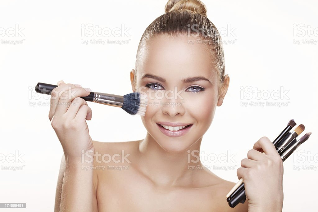 Beauty with the make-up brush royalty-free stock photo