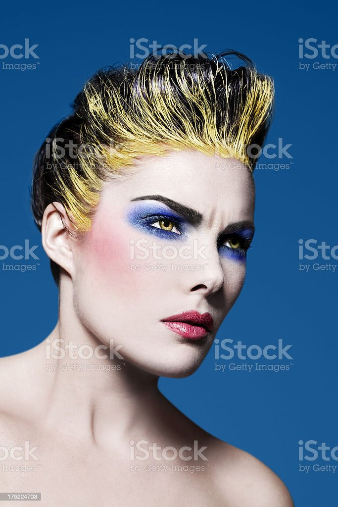 Beauty with Yellow Hair and Eyes royalty-free stock photo