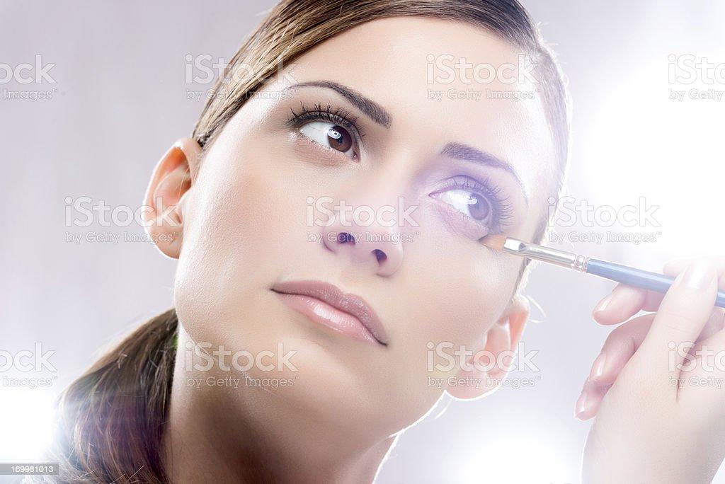 Beauty woman applying make-up. royalty-free stock photo