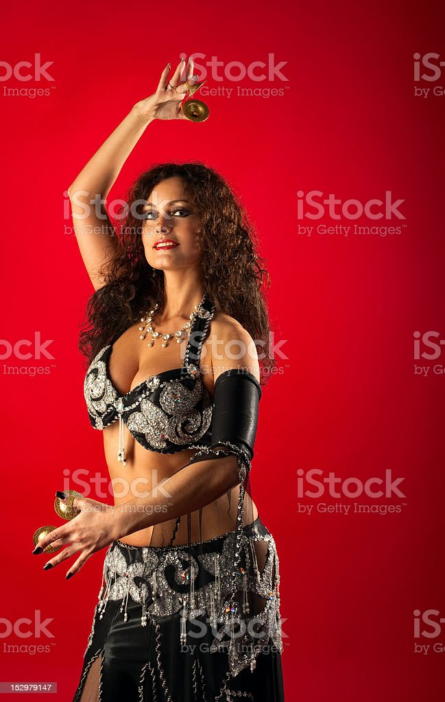 Beauty woman belly dance with finger cymbals stock photo