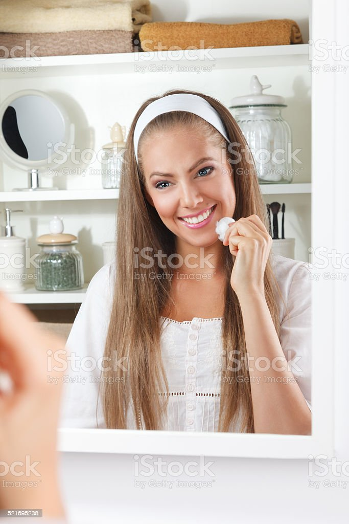 Beauty woman cleaning her face stock photo