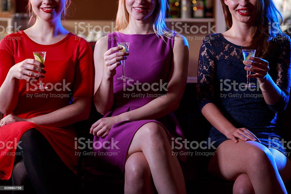 Beauty woman drinking shots stock photo