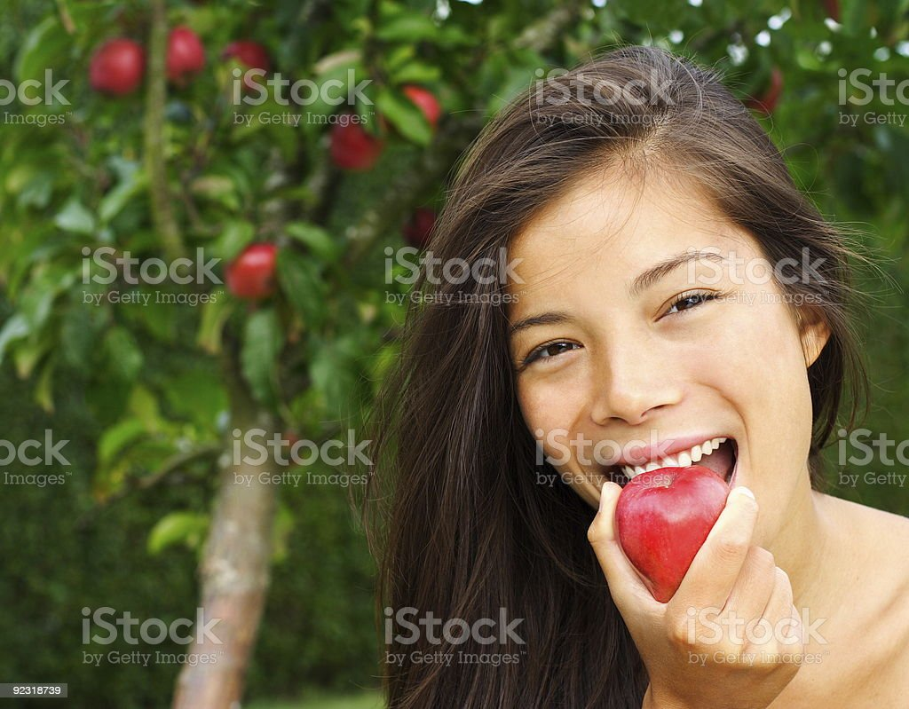 Beauty woman eating red apple royalty-free stock photo