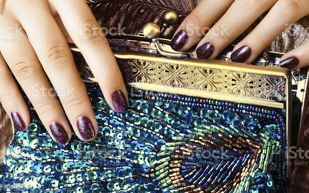 beauty woman fingers holding luxury bag stock photo