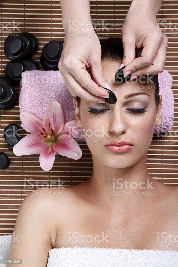 beauty woman having cosmetic massage,facial treatment royalty-free stock photo