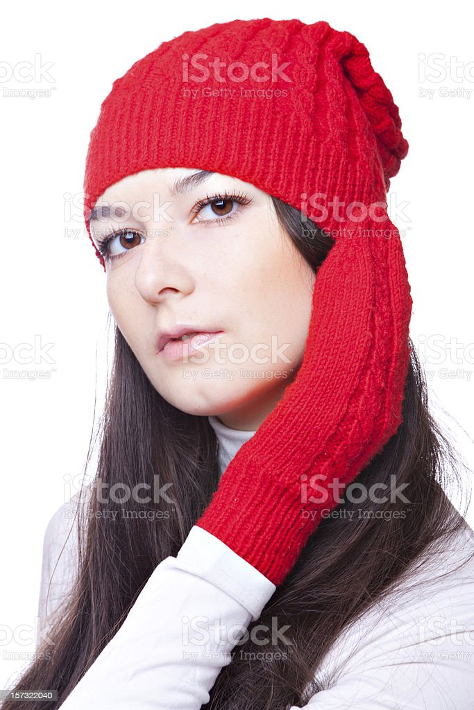 beauty woman in a red cap and mittens royalty-free stock photo