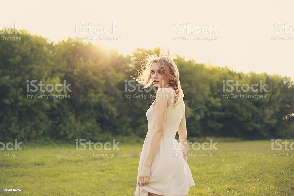 beauty woman in dress portrait over bright daylight background stock photo