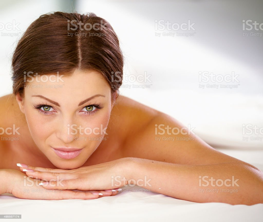 Beauty woman in spa lying down stock photo
