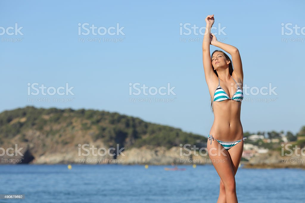 Beauty woman showing her laser hair removal body stock photo