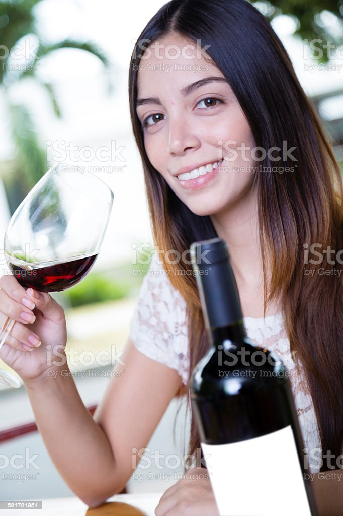 Beauty woman smiling with a cup of wine stock photo