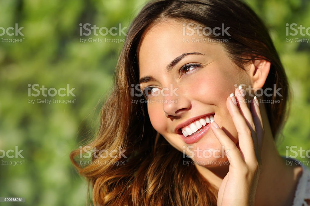 Beauty woman with a perfect smile and white tooth stock photo