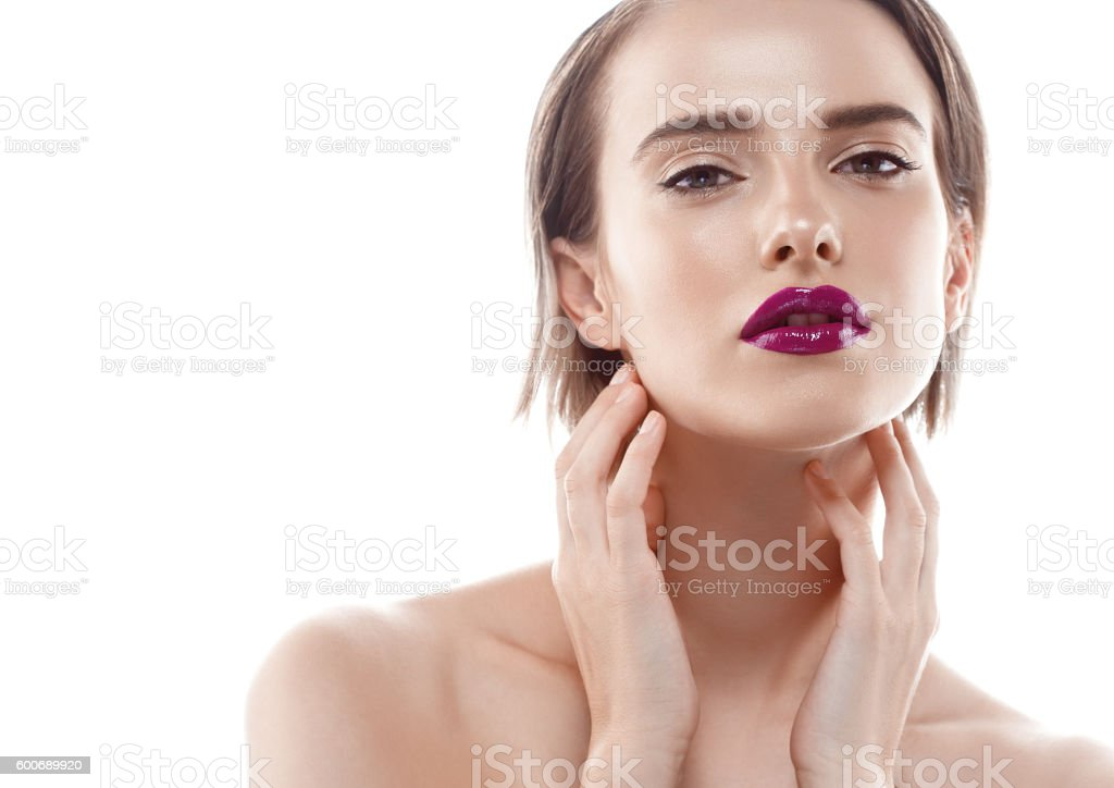 Beauty Woman with color lips purple red Portrait. White background. stock photo