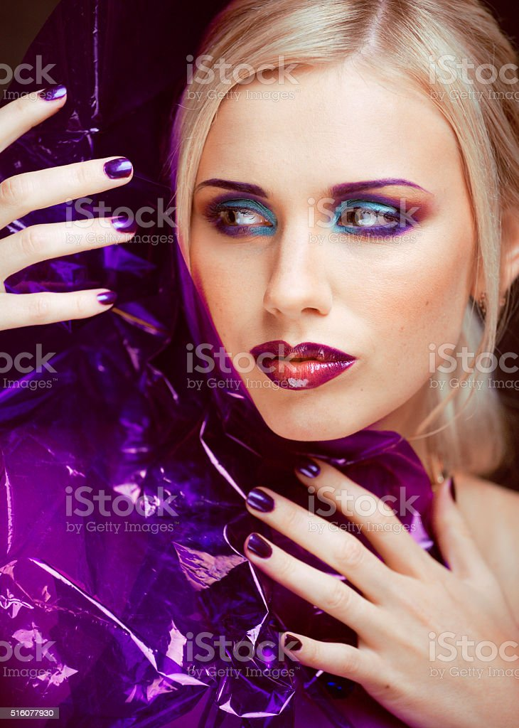 beauty woman with creative make up, many fingers on face stock photo