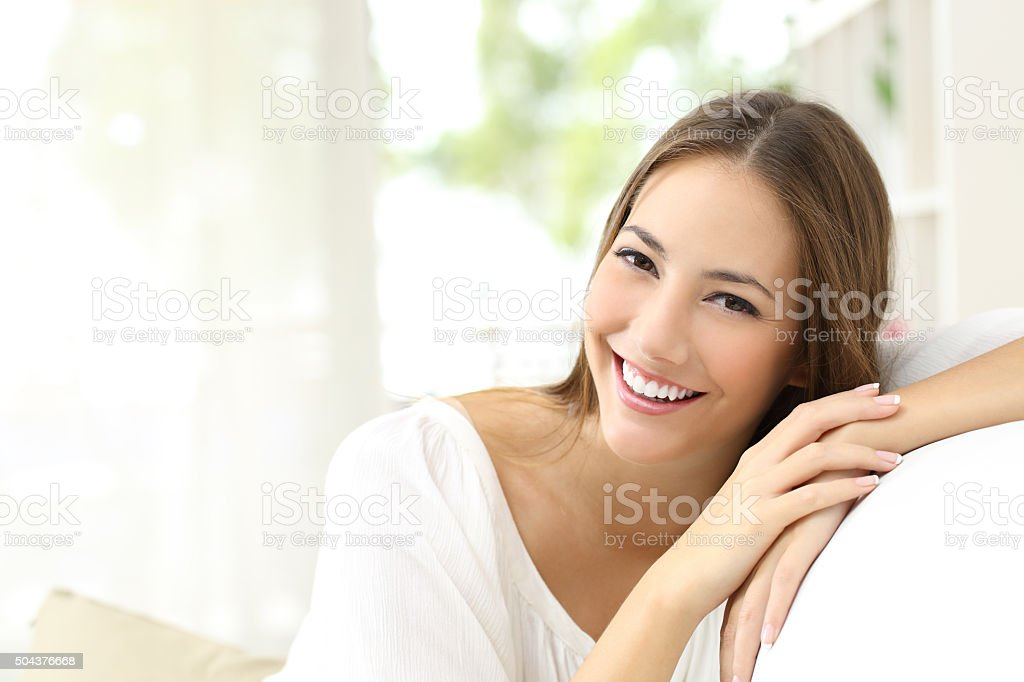 Beauty woman with white smile at home stock photo