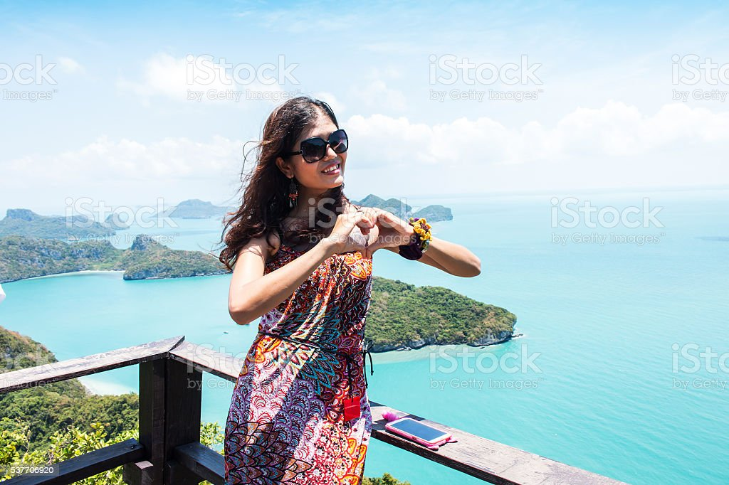 beauty women smile on blue sky and sea stock photo