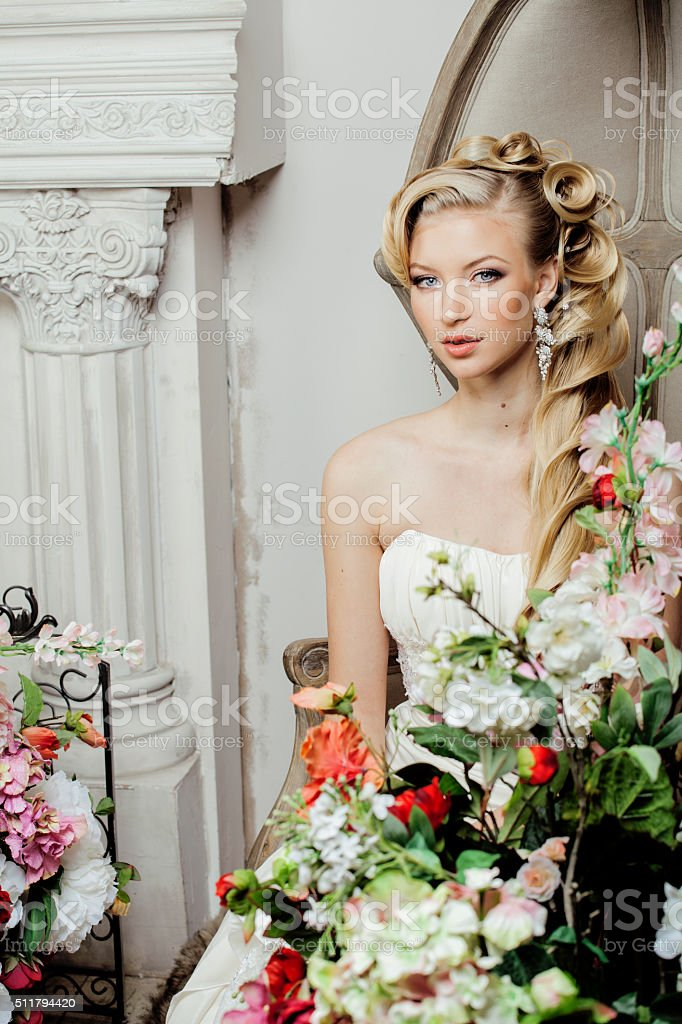 beauty young bride alone in luxury vintage interior with a stock photo