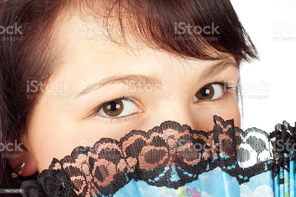 beauty young girl with fan, closeup royalty-free stock photo