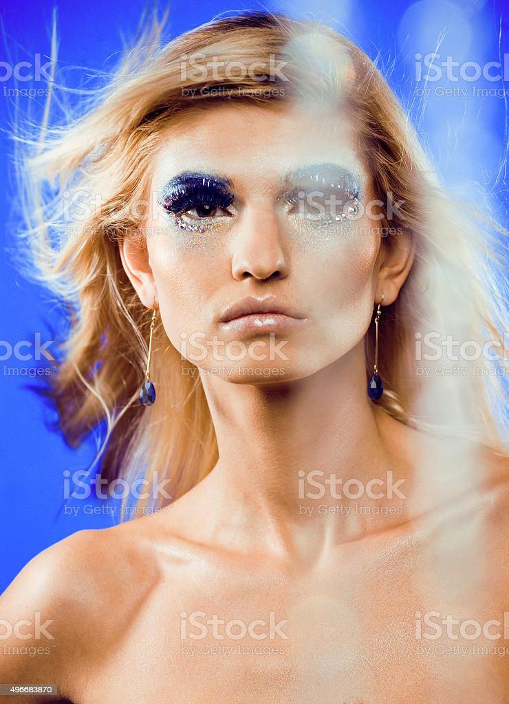 beauty young snow queen in fairy flashes with hair crown stock photo