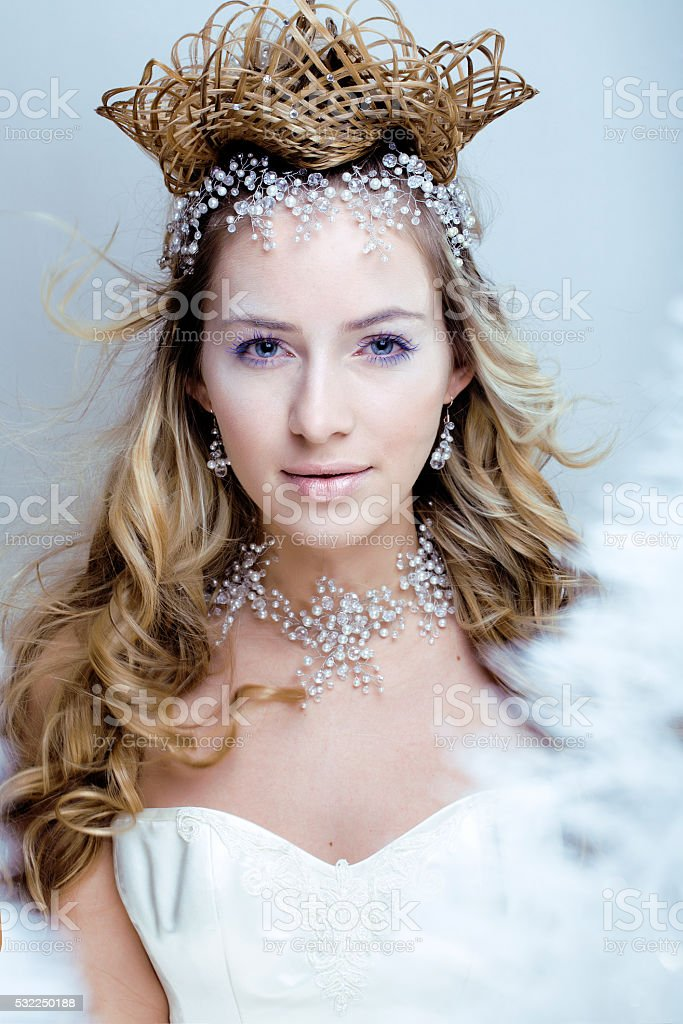beauty young snow queen with hair crown on her head stock photo