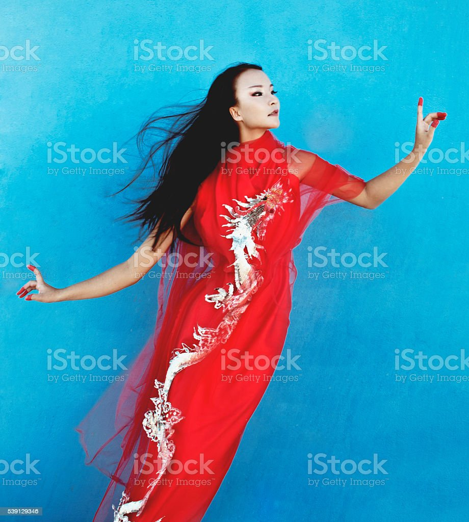 beauty young vietnamese woman in red national ethnic costume stock photo