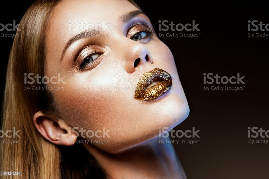 Beautyful girl with gold glitter on her face stock photo