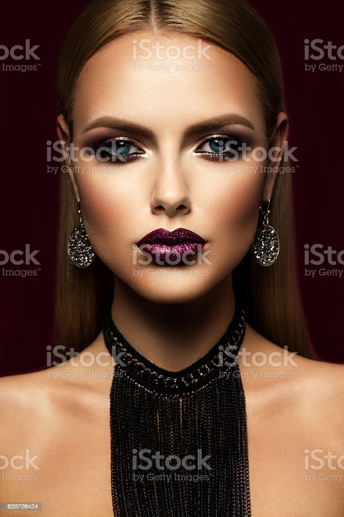 Beautyful girl with pink glitter on her lips stock photo