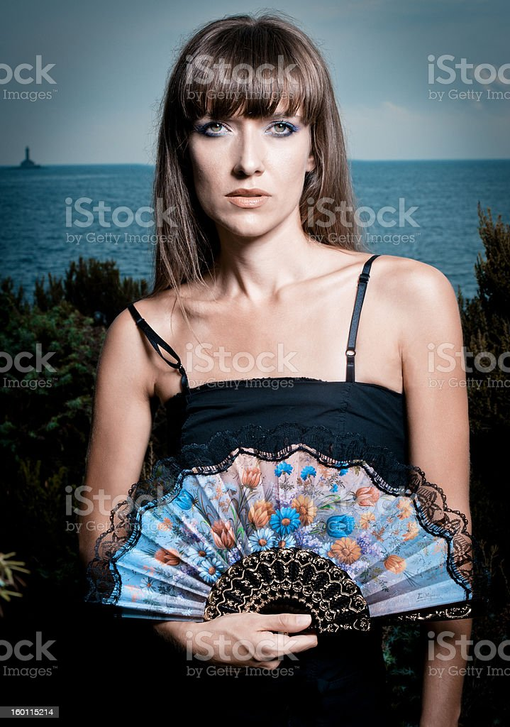 Beautyful woman with hand fan stock photo