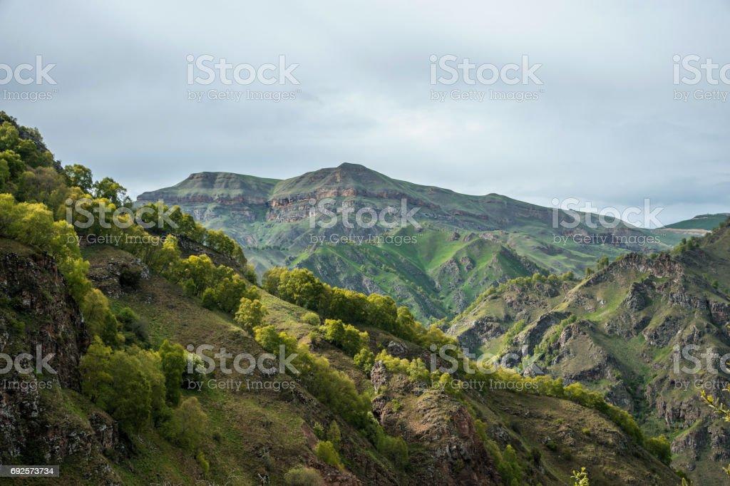 beautyfull Green Caucasus Mountains on foggy sky stock photo