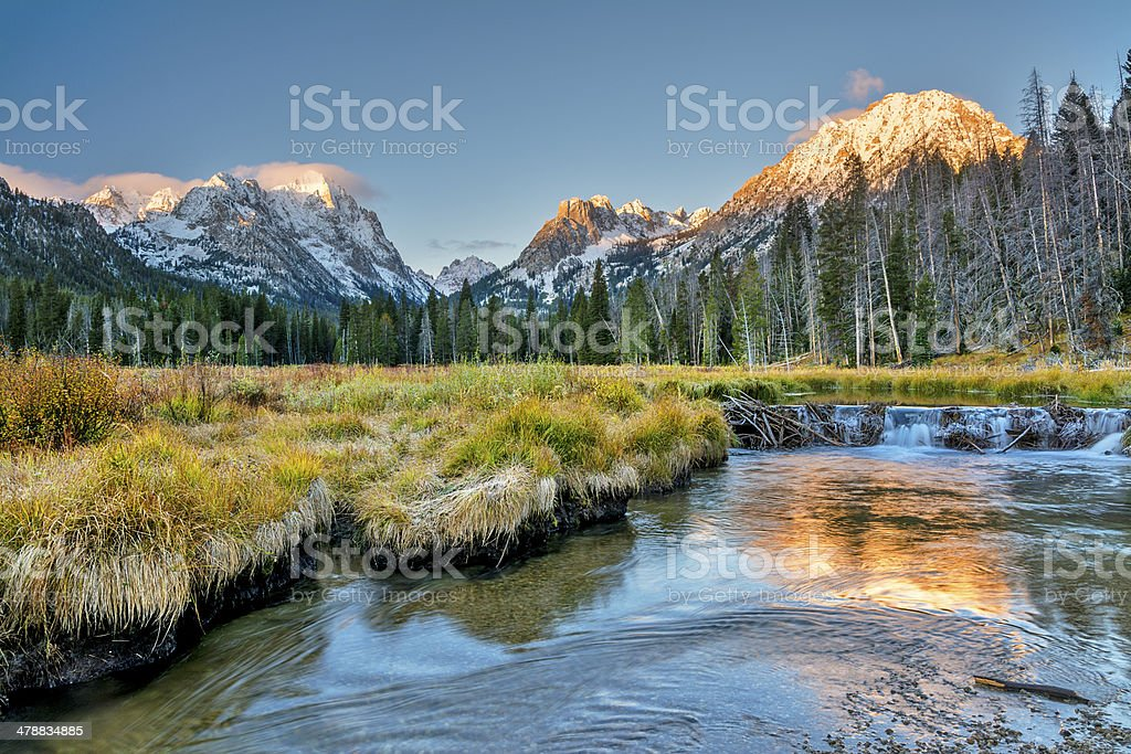 Beaver dam and snow capped mountains stock photo