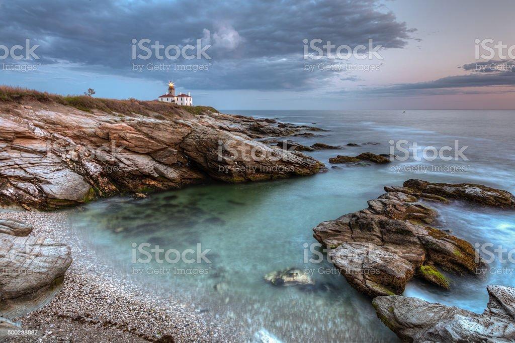 Beavertail Lighthouse at Sunset stock photo