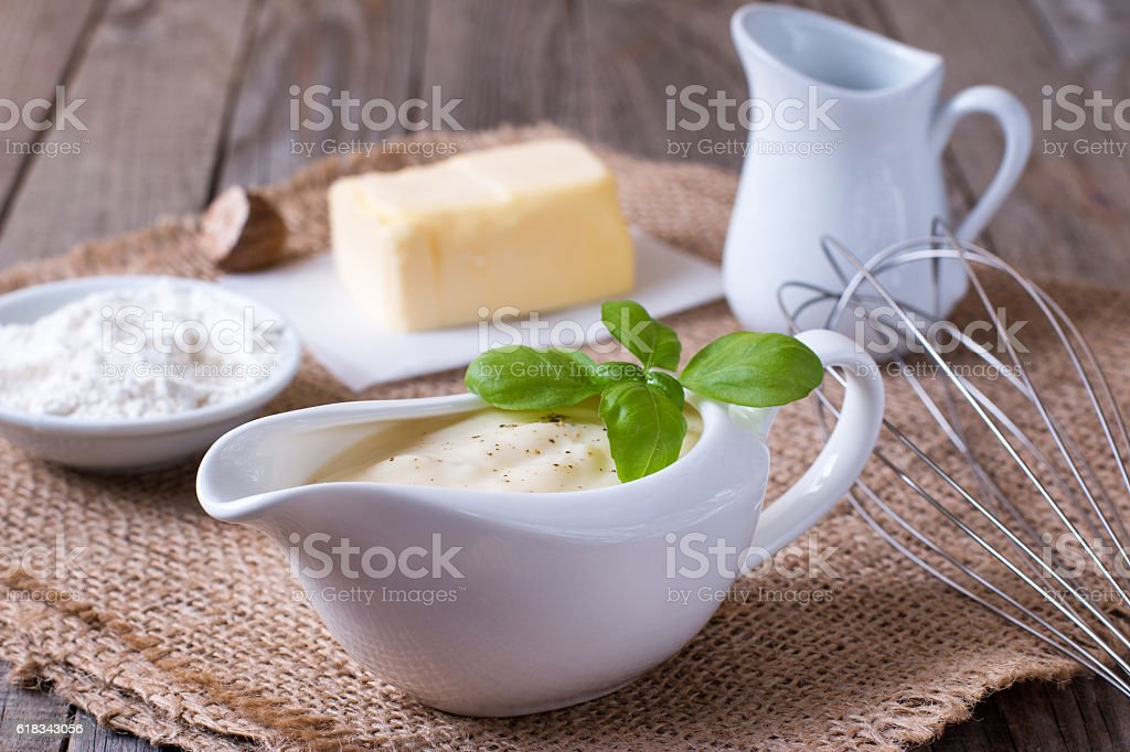 Bechamel sauce for traditional European dishes stock photo