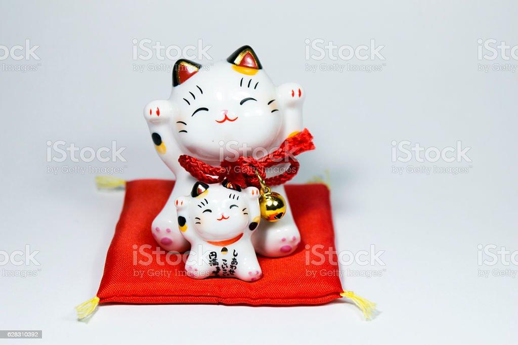 Beckoning cat also known as maneki neko isolated on white stock photo