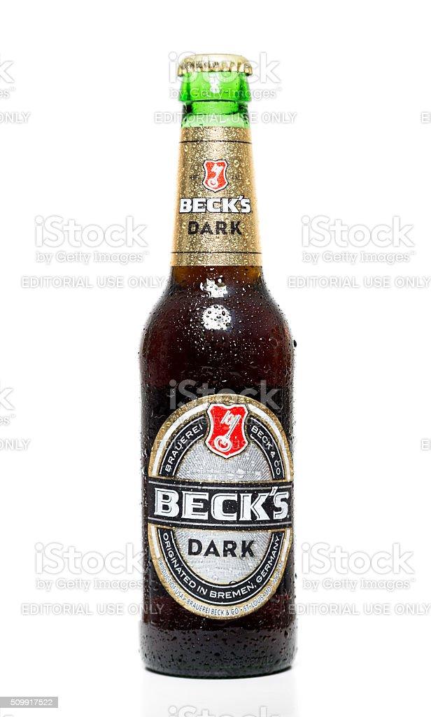Beck's dark beer bottle with water drops stock photo