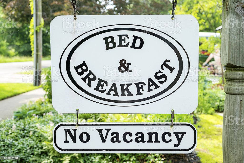 A bed and breakfast sign that says no vacancy stock photo