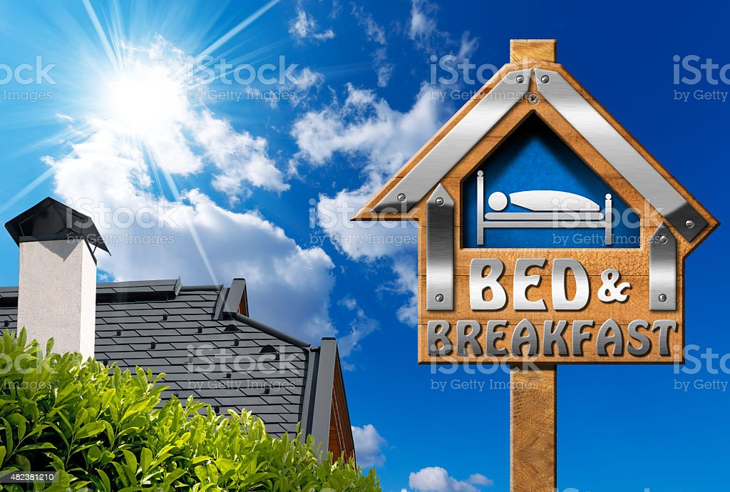 Bed and Breakfast Sign with House stock photo