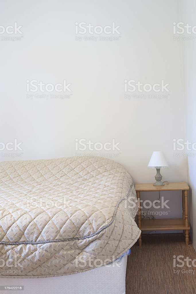 Bed and lamp royalty-free stock photo