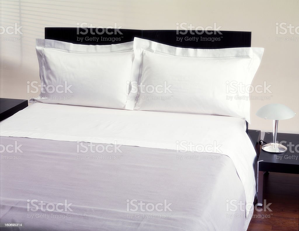 bed and nightstands stock photo