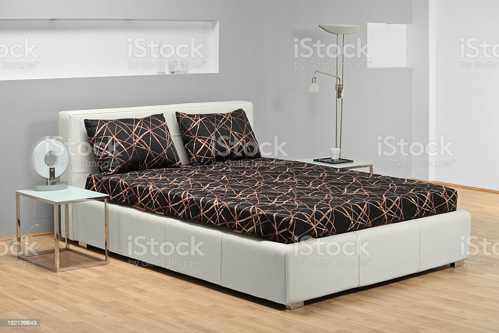 Bed in a bedroom royalty-free stock photo