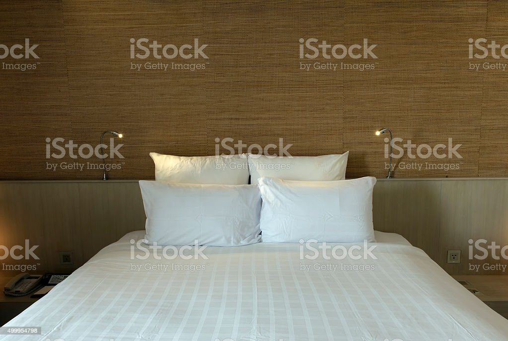 bed in a business hotel room stock photo