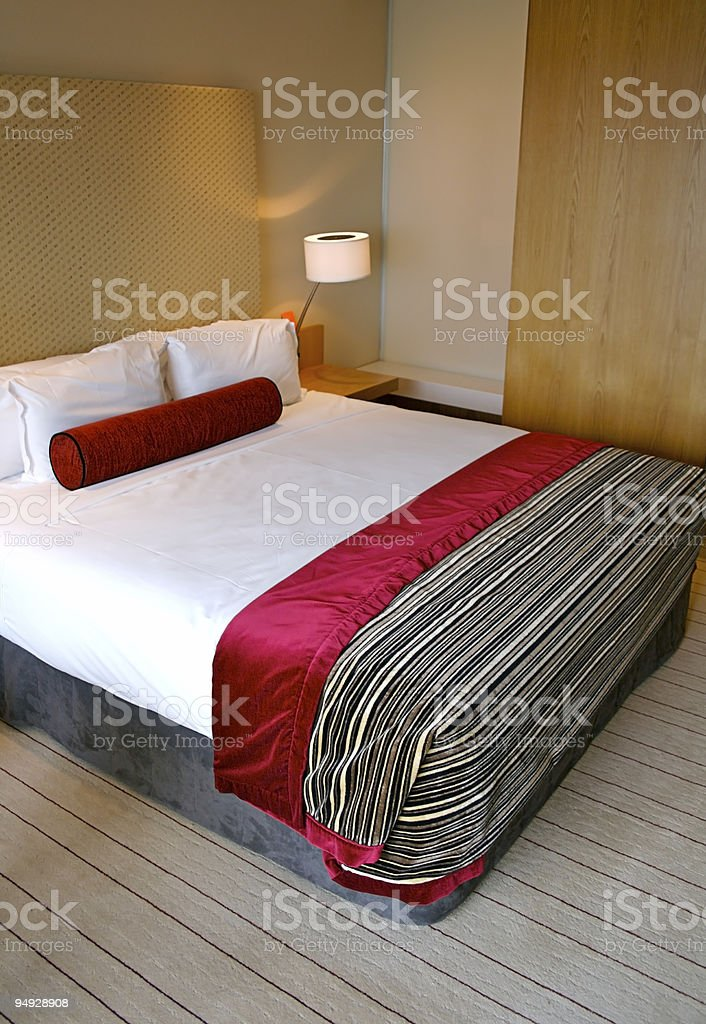 Bed in a five star hotel room royalty-free stock photo