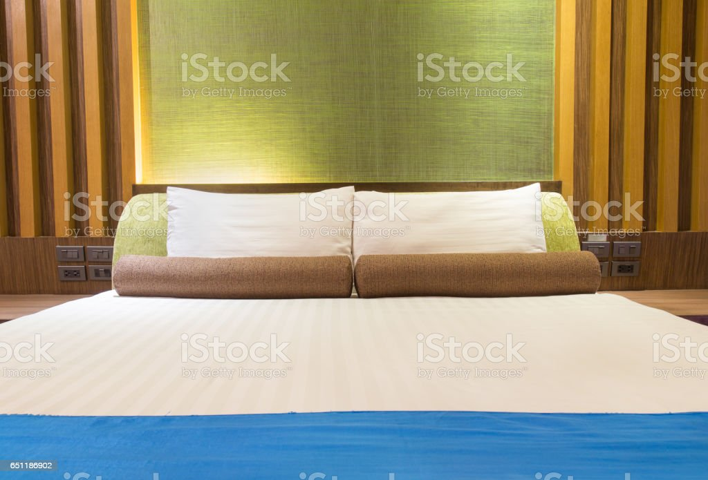 Bed in a hotel room at night, Thailand stock photo